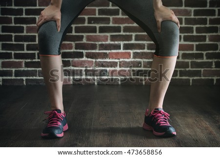 take rest after fitness exercise training, healthy lifestyle concept, indoors gym on wooden floor brick wall background
