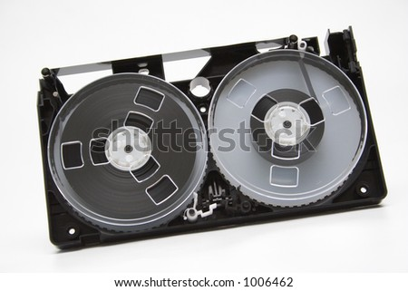 Take to pieces VHS cassette on white background - stock photo