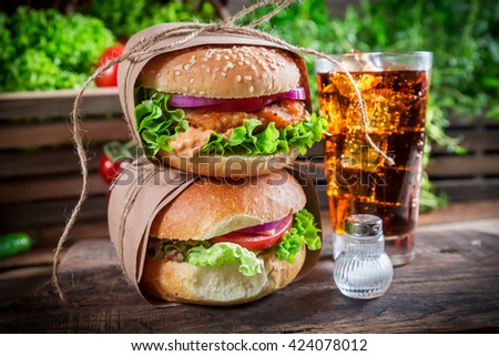 Takeaway healthy hamburger with cold drink - stock photo