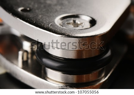 Taken apart computer hard disk drive (HDD) closeup background
