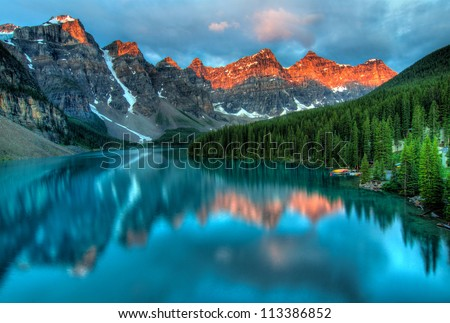 Taken at the peak of color during the morning sunrise at Moraine lake in Banff National park. - stock photo