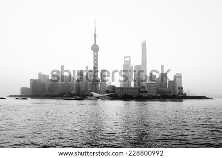 Taken from Huangpu Park on The Bund at sunrise, this was one of the clearest mornings of the year. This iconic view of modern Shanghai shows the Pearl Tower, Conference Centre and Shanghai Tower. - stock photo