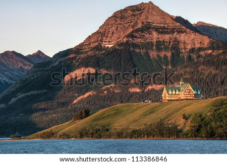 Taken right at sunrise as the orange morning sun lite the mountain and hotel. - stock photo