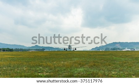 Takeoff plane in airports green field  - stock photo