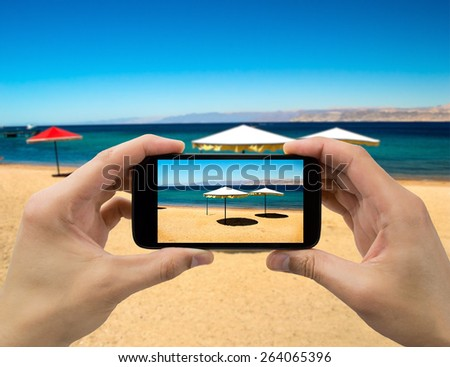 taking a photo of the beach - stock photo