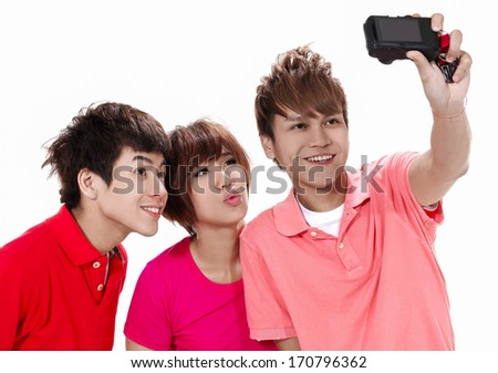 taking a photo of themselves with a mobile phone - stock photo
