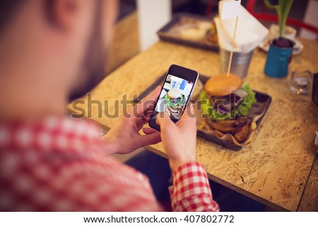 Taking a pic of food for social network site - stock photo