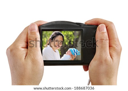 Taking a Picture of Mother and Baby isolated on white - stock photo