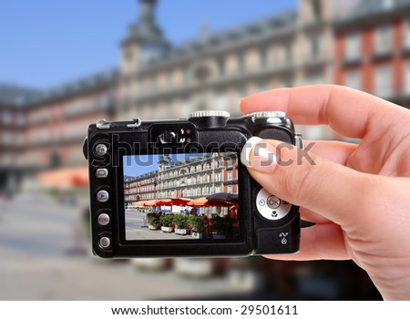 Taking a picture of Plaza Mayor in Madrid, Spain