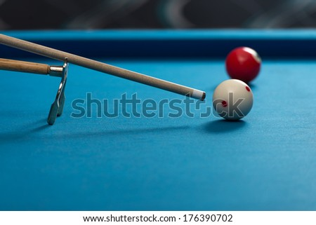 Taking Aim - Young Man Lining To Hit Ball On Pool Table