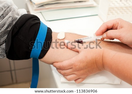 Taking blood from a vein - stock photo
