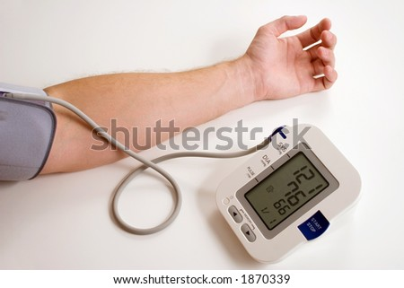 Taking blood pressure - stock photo