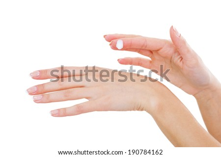Taking care of skin. Close-up of woman applying cream on hand