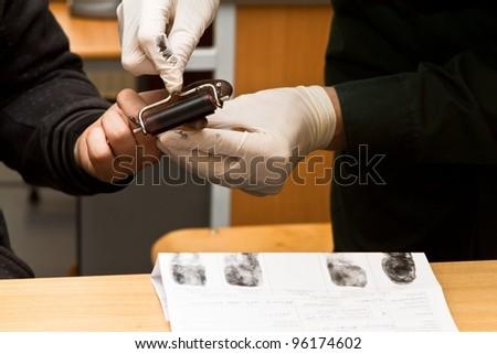 taking fingerprints - stock photo