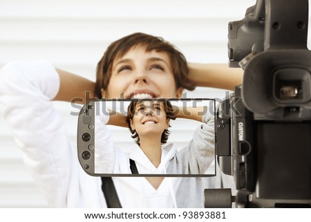 Taking movie with professional camcorder - stock photo