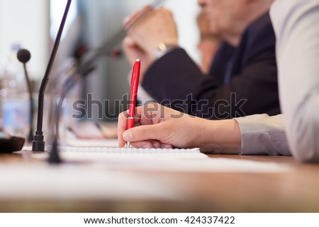 taking notes at the conference  - stock photo