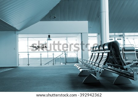 Taking Off Airplane, view from airport terminal. - stock photo