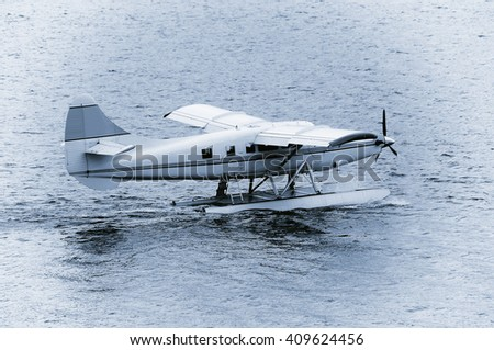 Taking off the small passenger plane from the water surface.