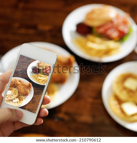 taking photo of food with smartphone - stock photo