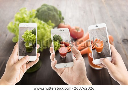 Taking photo of vegetable Juices with fresh ingredients - stock photo
