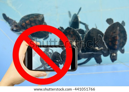 Taking photo on smart phone concept with prohibit sign - stock photo