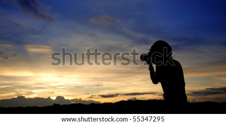 taking photograph of sunset - stock photo