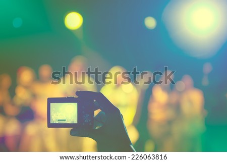 Taking picture at a music concert - stock photo