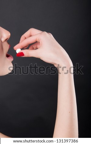 taking pill - stock photo