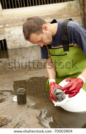 Taking samples of the soil and groundwater, environmental research. - stock photo