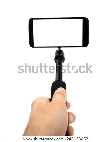 taking selfie - hand hold monopod with mobile phone - stock photo