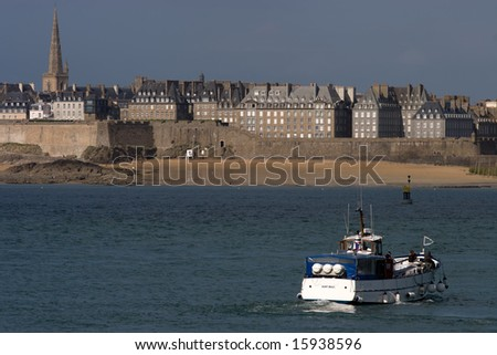 Taking the ferry from Dinard to Intra-Muros, the historical walled city of St Malo, France. - stock photo