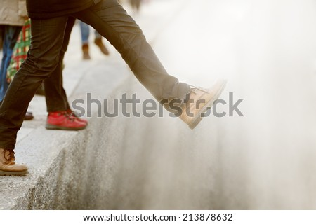 Taking the step into the unknown - stock photo