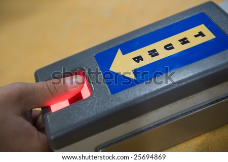 Taking thumbprint with digital scanner - stock photo