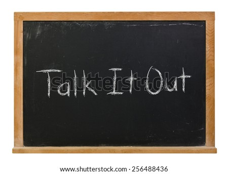 Talk it out written in white chalk on a black wood framed chalkboard isolated on white - stock photo