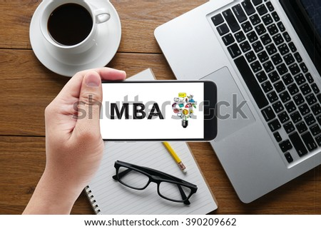Talking Communication MBA Concept message on hand holding a phone, top view, table computer coffee and book - stock photo
