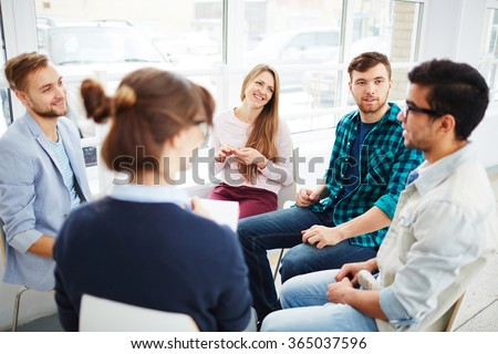 Talking in group - stock photo