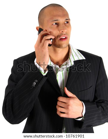 Talking On My Cell Young man in suit is using his cell phone. Isolated over white. - stock photo