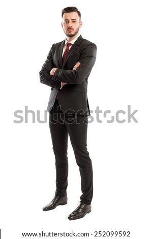 Tall and successful business man - stock photo