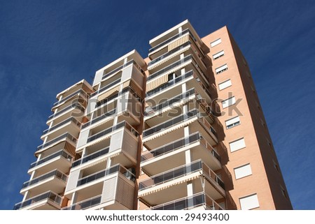 Tall apartment building in Benidorm, Spain. Residential architecture. - stock photo