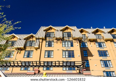 Tall apartment building in Whistler, Vancouver, Canada. Residential architecture - stock photo