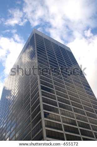 Tall building with reflecting clouds