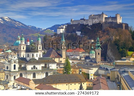 Tall church towers and castle above Salzburg old town, Austria - stock photo