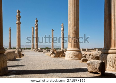 Tall columns in area of ruined city Persepolis, built in 6th century BC. UNESCO declared citadel of Persepolis a World Heritage Site in 1979 - stock photo