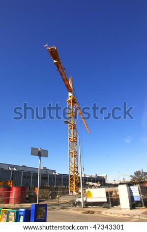 Tall crane at work. - stock photo