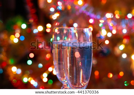 tall glass of champagne on New Year's festive table