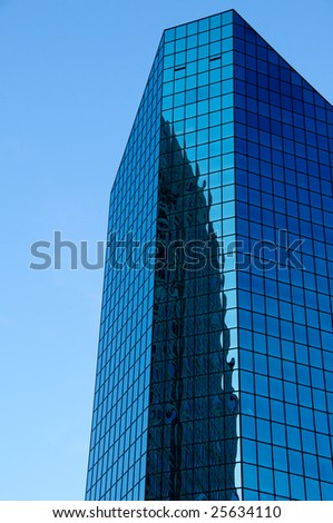 Tall office building with reflection - stock photo