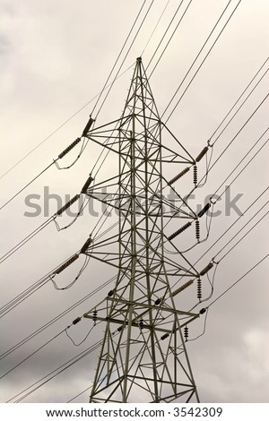 Tall power line station overhead in a thunder storm. - stock photo