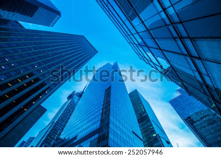 Tall skyscrapers during evening hours - stock photo