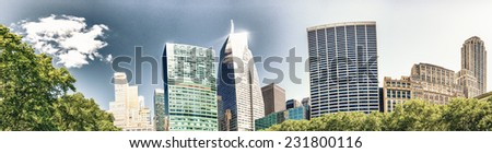 Tall skyscrapers over Bryant Park trees, Manhattan - New York City. - stock photo