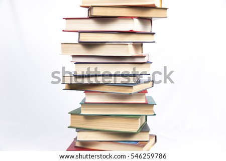 tall stack of books with colored covers on a white background